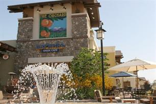 The Orchard Shopping Center with Fountain and Tables