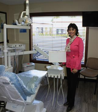 Woman standing in dentists office.